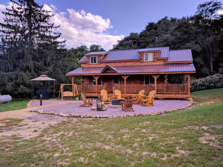 view of a cabin and outdoor fire pit