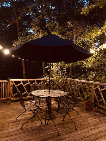 Cozy back deck, surrounded by woods; perfect for an afternoon drink.