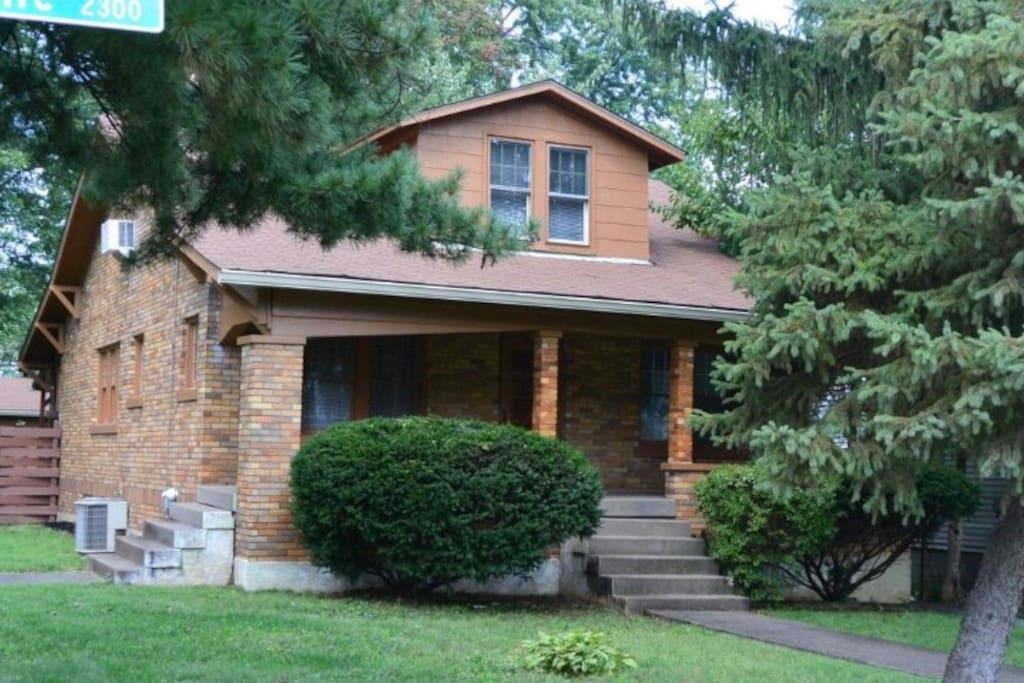 Relax on the spacious front porch of this Louisville home close to the Watterson Expressway off Bardstown Road