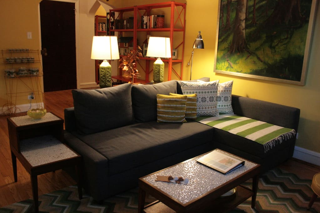 A great place to lounge-- the living room is set up with comfy seating.  The sofa converts to a full-size bed.