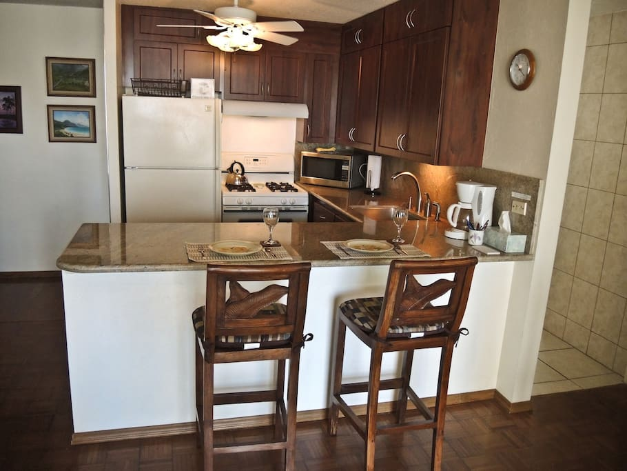 The fully equipped kitchen features a gas stove and dishwasher.