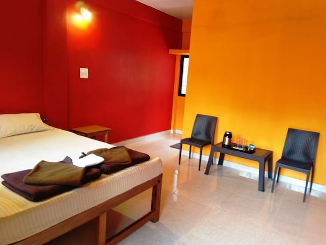 Deluxe Double Occupancy AC Room - Red & Yellow