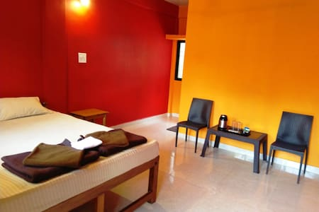 Deluxe AC Room Red & Yellow 2 mins walk to beach
