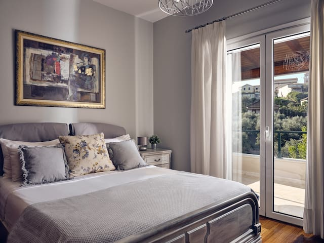 Bedroom with private balcony and view