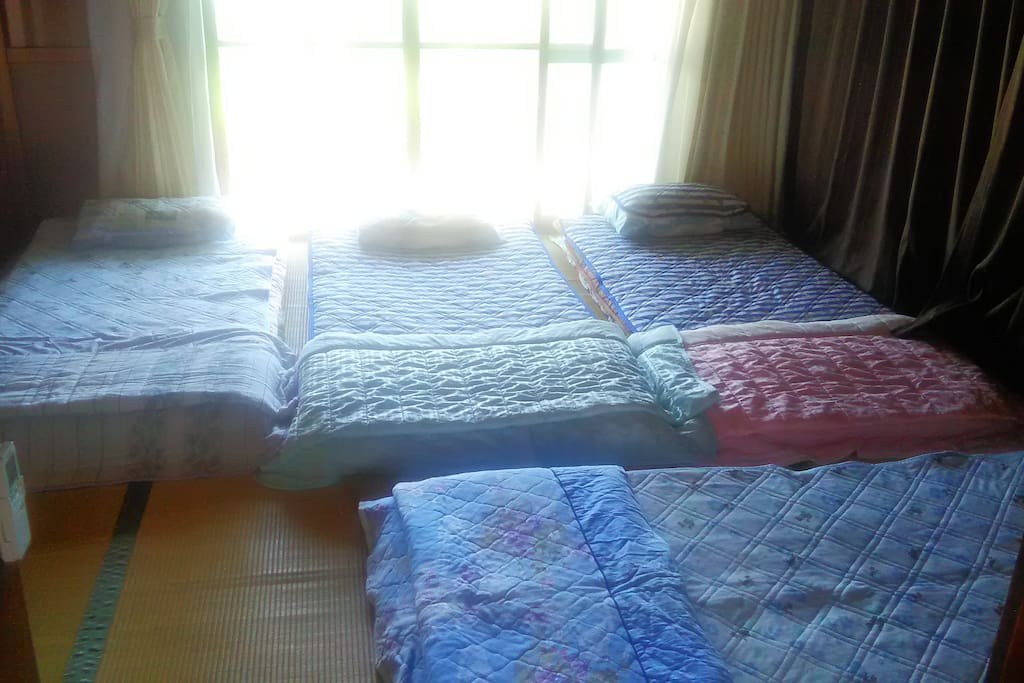 Large sunny room with 4 futon beds made up, Can prepare 5 single futons or 1 double and 3 singles