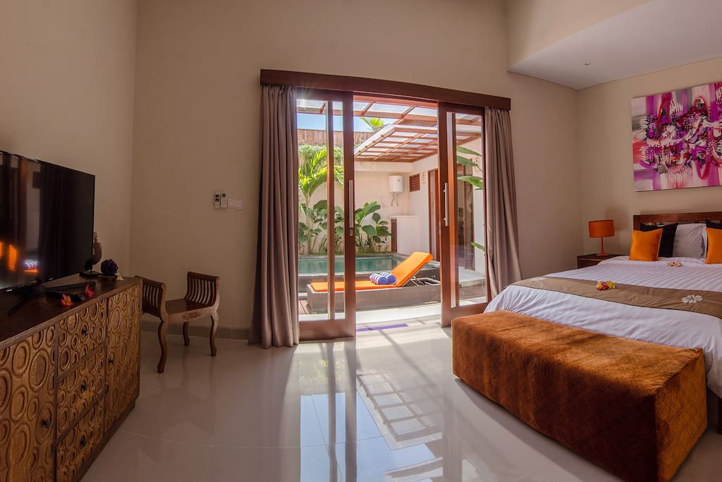 Super spacious bedrooms, block-out curtains,  kingsize bed, TV and storage.