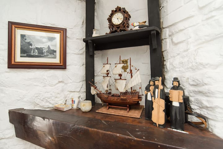 Above the fireplace ( woodturner out of shot)