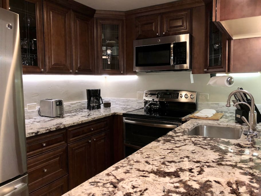 Gourmet kitchen with high end granite and stainless appliances:  full size french door fridge with filtered wate, double oven, microwave, dishwasher, coffee maker