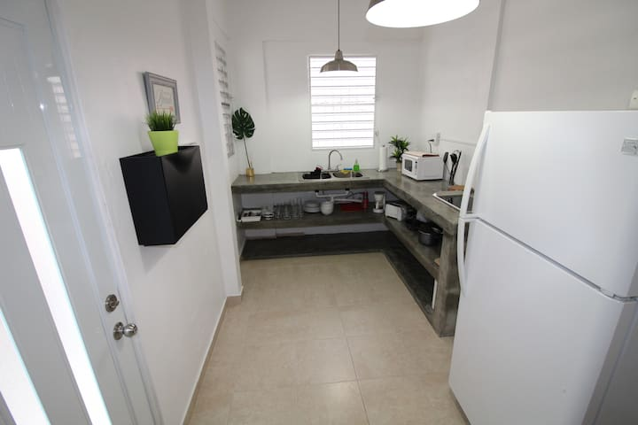 Large concrete cement kitchen so you can cook your own meals. It has a stove, fridge, microwave, coffee maker, toaster, etc.