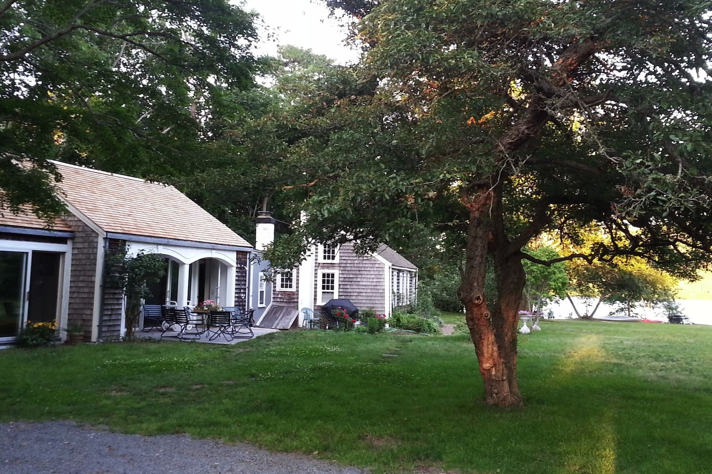 Historic lake home with a new addition with skylights and sliding doors to patio.  Short walk into town or to saltwater Cape Cod Bay.  Near famous Mayflower Beach.