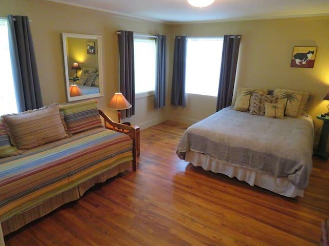 Bedroom #3 with 1 queen and trundle bed, dresser & walk in closet