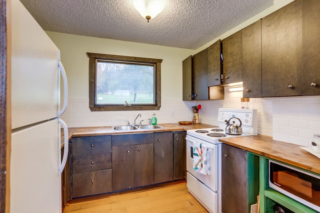 Small country kitchen overlooks the orchard