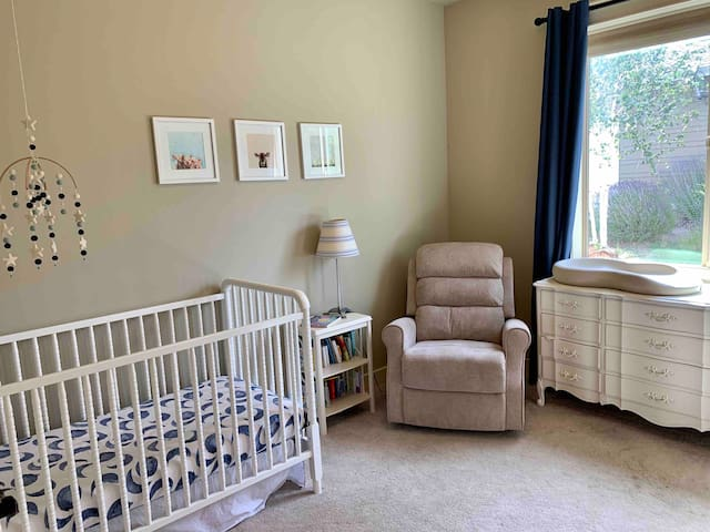 Nursery adjacent to the master on the main floor. Rock your little one in the cozy chair and get a good night's sleep with blackout curtains.