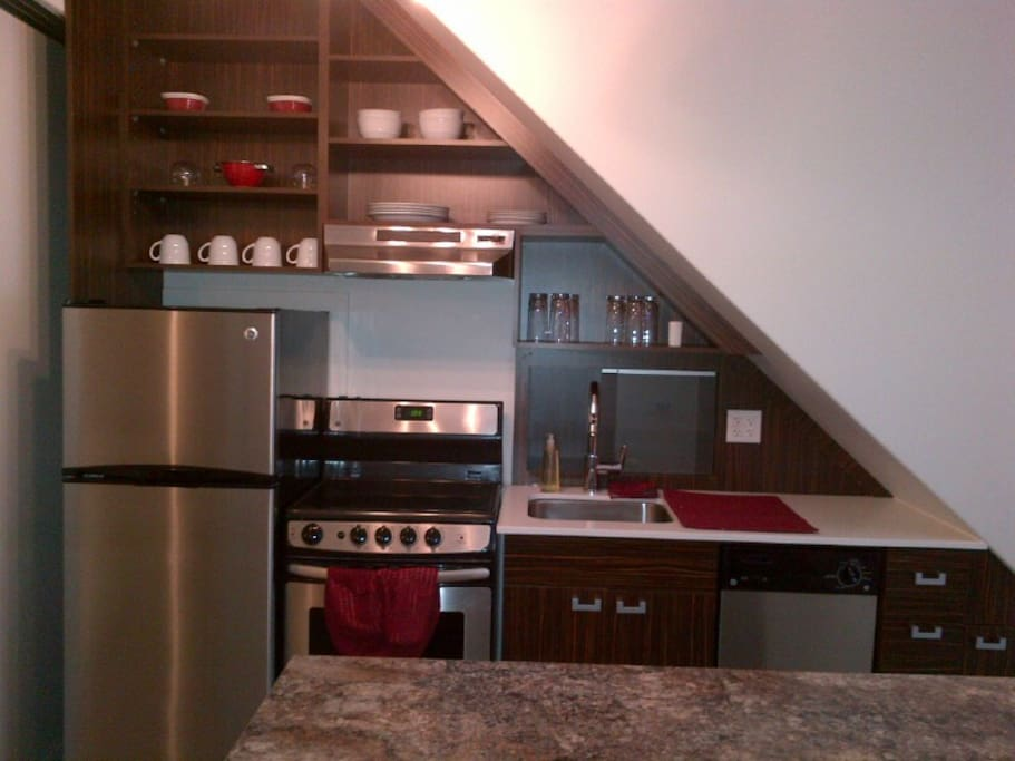 Kitchen with dishwasher, microwave and Keurig