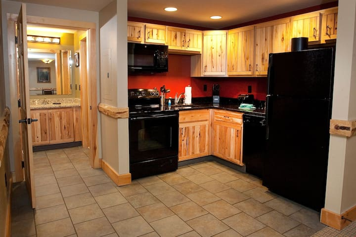 Prepare delicious homemade meals in the beautiful wood-furnished kitchen