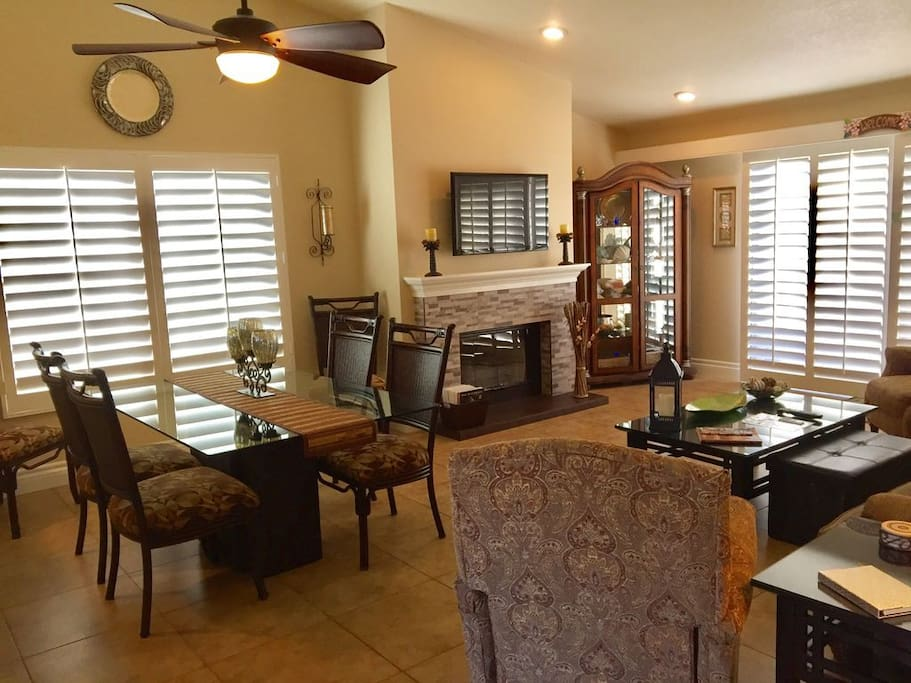 Large Dining Room that seats up to 8 guests and updated gas fireplace with amber colored glass