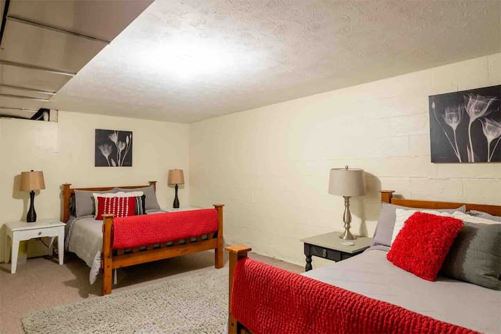 Bedroom #4 is a large non conforming bedroom in the basement with two full size beds.