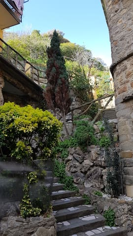 The terrace can be seen at the top of these two flights of stairs, one of the prettiest corners in Moneglia
