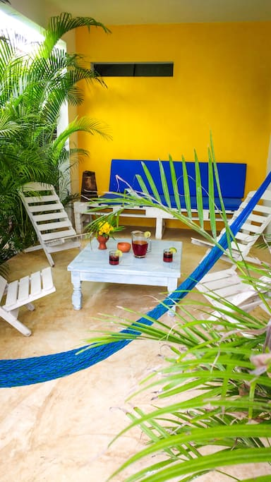 Enjoy relaxing on the patio surrounded by tropical garden