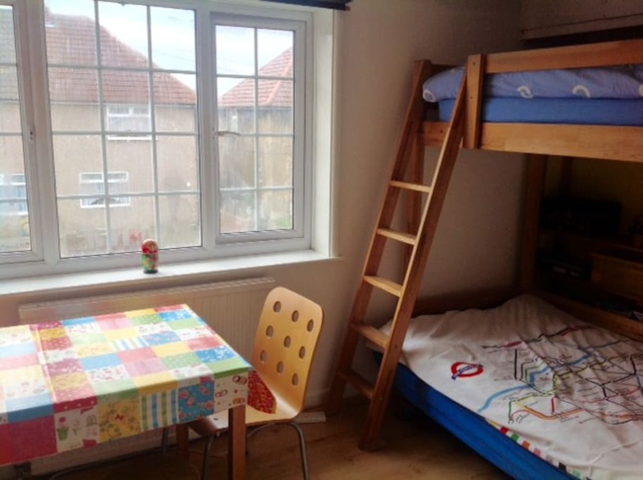 or the large room with bunk bed and a double bed sofa