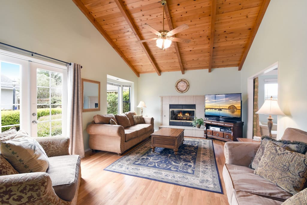 The large den has lots of seating, a fireplace and large flat screen TV.  The couch folds out to a queen size bed.