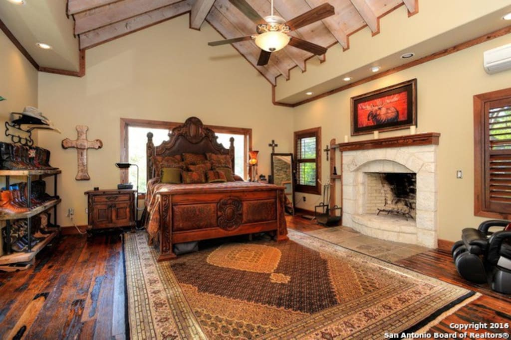 Master suite with fireplace and Private Bathroom.