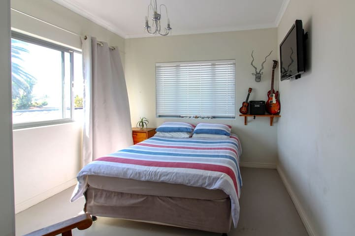 This is the second bedroom which is a bit smaller but has a magnificent view of Melkbos. This bedroom has been renovated recently.