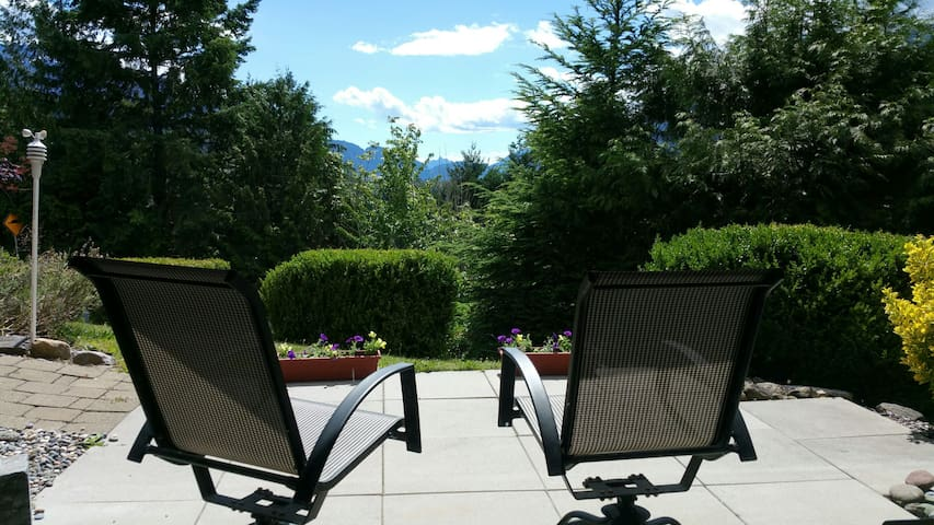 View of Howe Sound from first bedroom with queen bed. Small patio put front to enjoy the view.