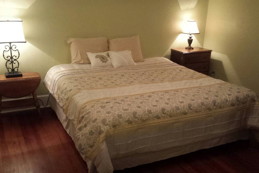 King size bed in the master bedroom (which is the front room by the front door of the house).