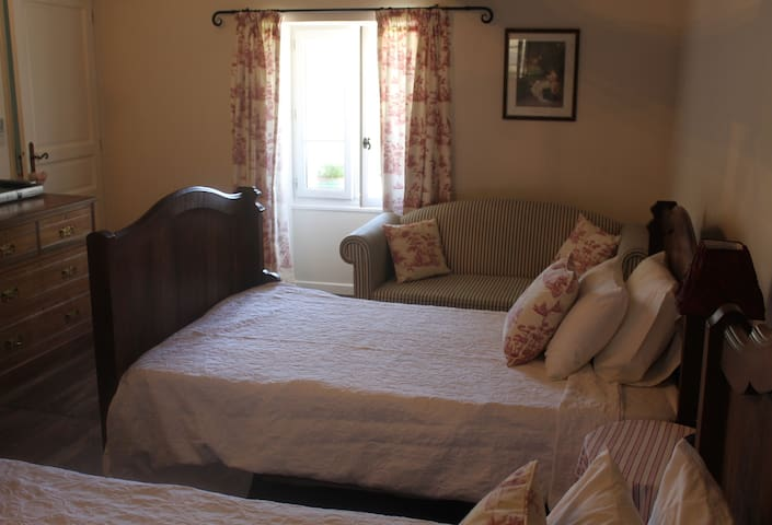 Twin room with two large single beds with air conditioning and en-suite wet room