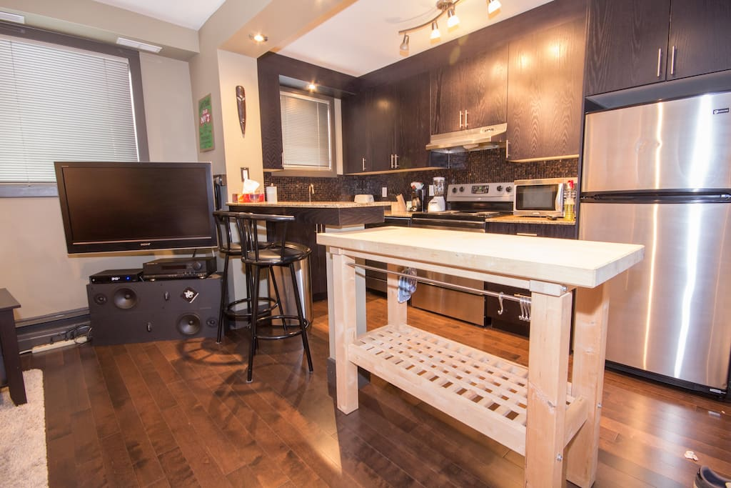 Open concept kitchen with butchers block table
