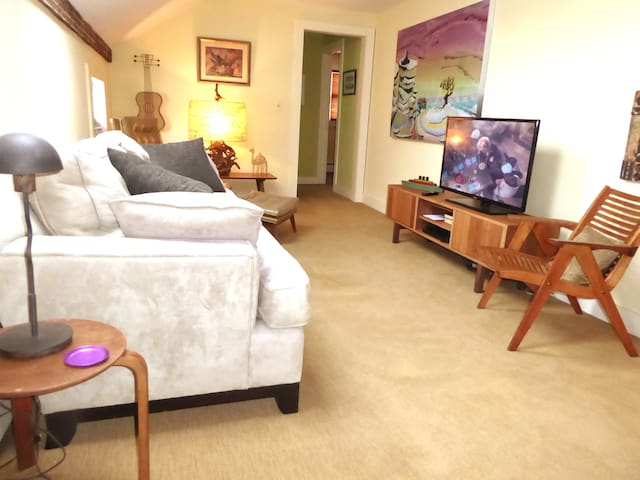 The upstairs TV room, with comfortable seating and cable TV