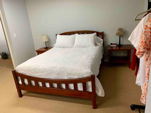 Bedroom, queen bed with heated mattress pad and hanging rack for clothing