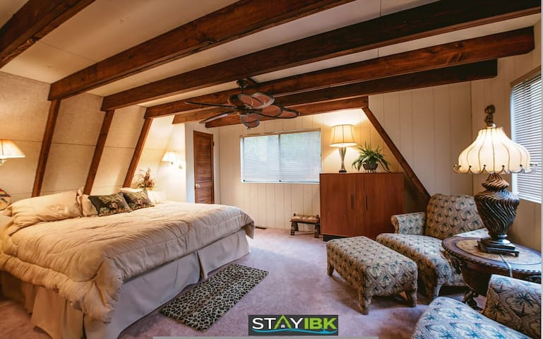 First bedroom on the main floor.  Houses two closets, king size bed, dresser, two plush chairs.  Reading lights right off the bed for easy access and ceiling fan.  TV in room with DVD player.