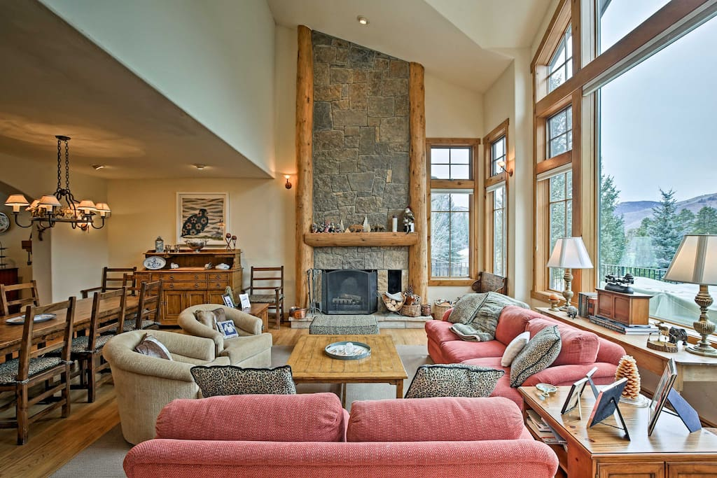 Towering windows showcase incredible mountain views just outside!