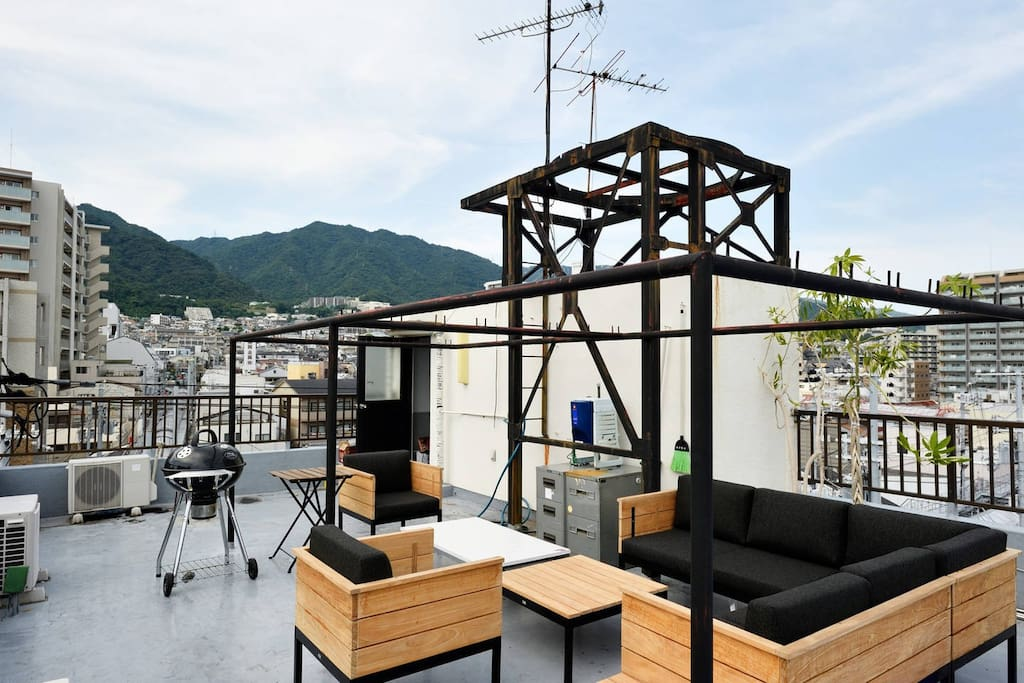 We have a rooftop with a great view, sofa and a BBQ grill