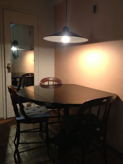 Dining area with overhead lamp.