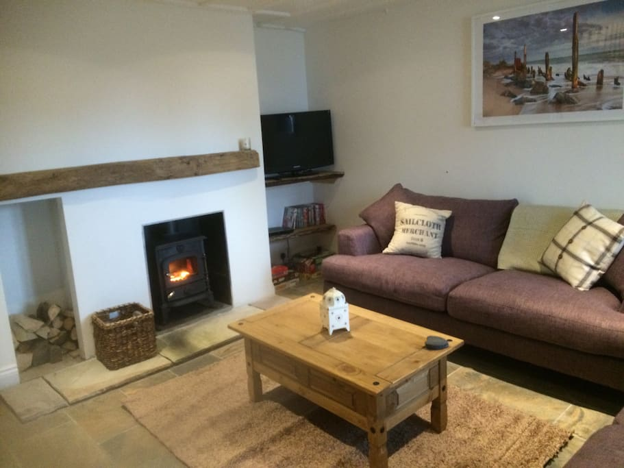 Living room,with 2 comfy sofas and log burner.TV and dvds