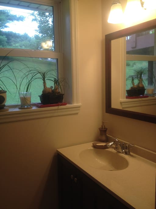 Tiled bathroom with window