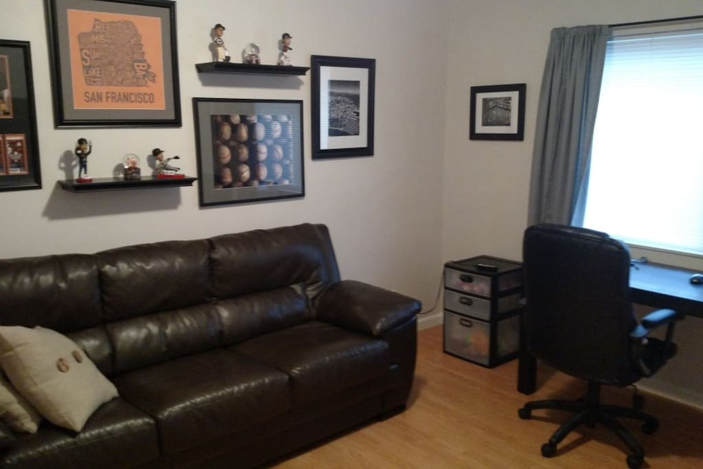 Man Cave/Office/Guest room.  Pull out couch with wall-mounted flat screen with Uverse and an Xbox 360 for Netflix. Or Madden.