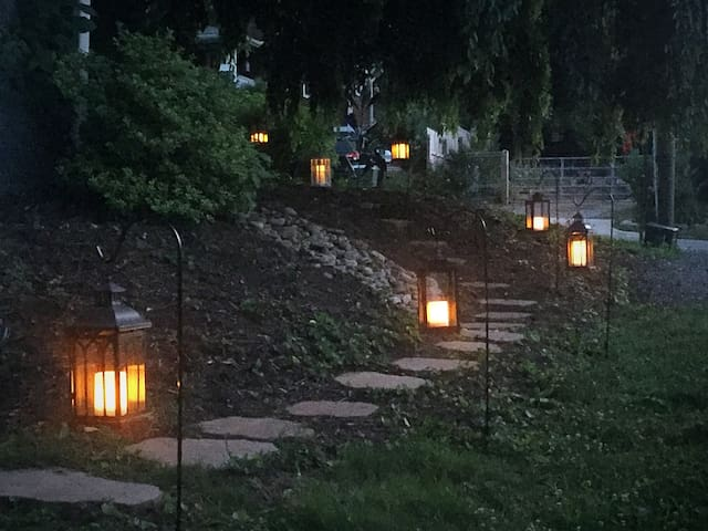 This magical garden path leads to your private apartment. (There are also motion-activated spotlights to help guide your way in the dark.)
