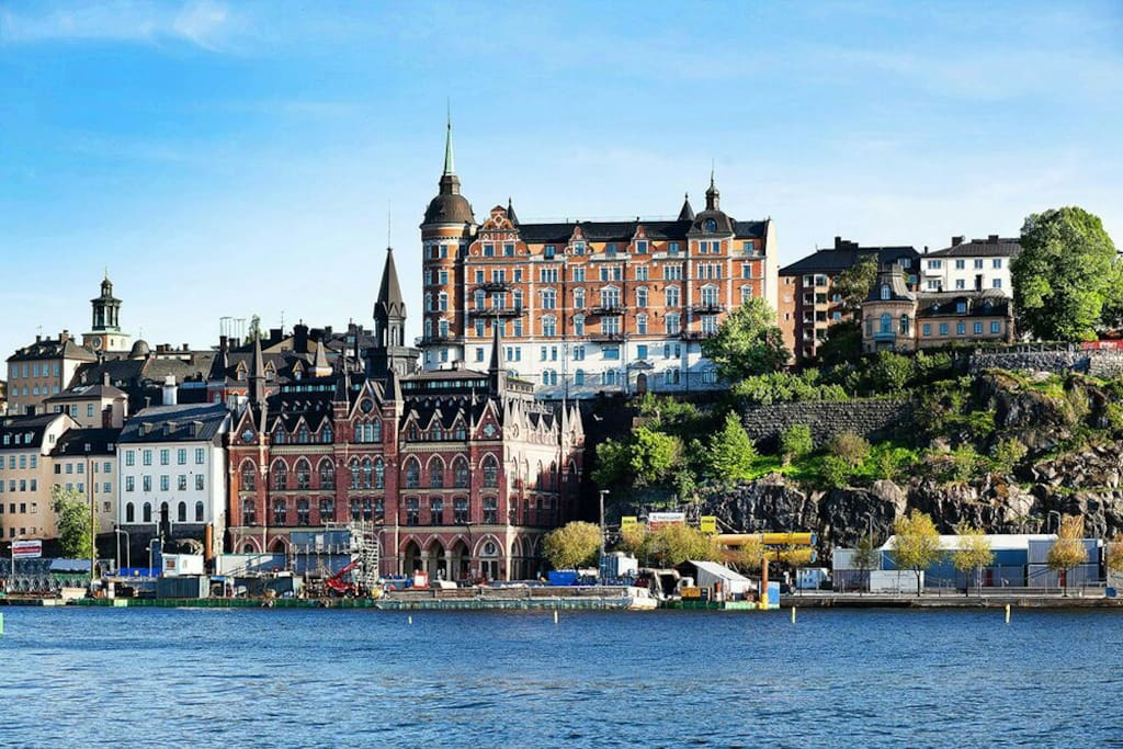 Södermalm, 10 min away by train or after two stops.