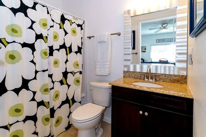 Bathroom with shower tub.