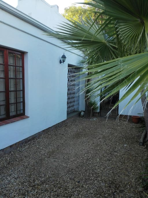 Private entrance with security gate and alarm
