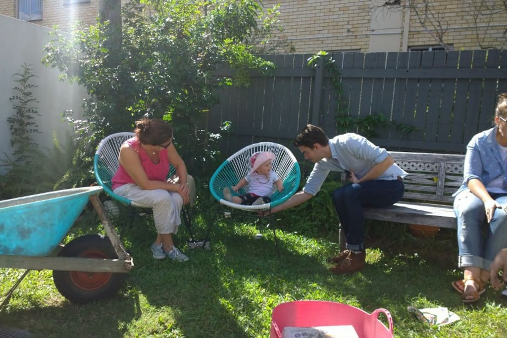 Ignore the wheelbarrow - here we are chilling out after a bit of gardening ! Just to give you an idea of the space between us and a neighbouring block of units ....