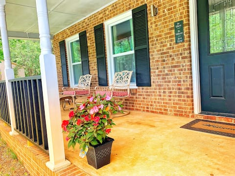Relax on charming southern covered front porch with a book and a cup of coffee in the morning! String lights will automatically turn on at dusk and off at sunrise.
