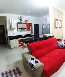 Casa 2 quartos alto padrão com Ar,suite e garagem!