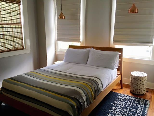 Sunny designer room in a charming 19th century downtown guest house
