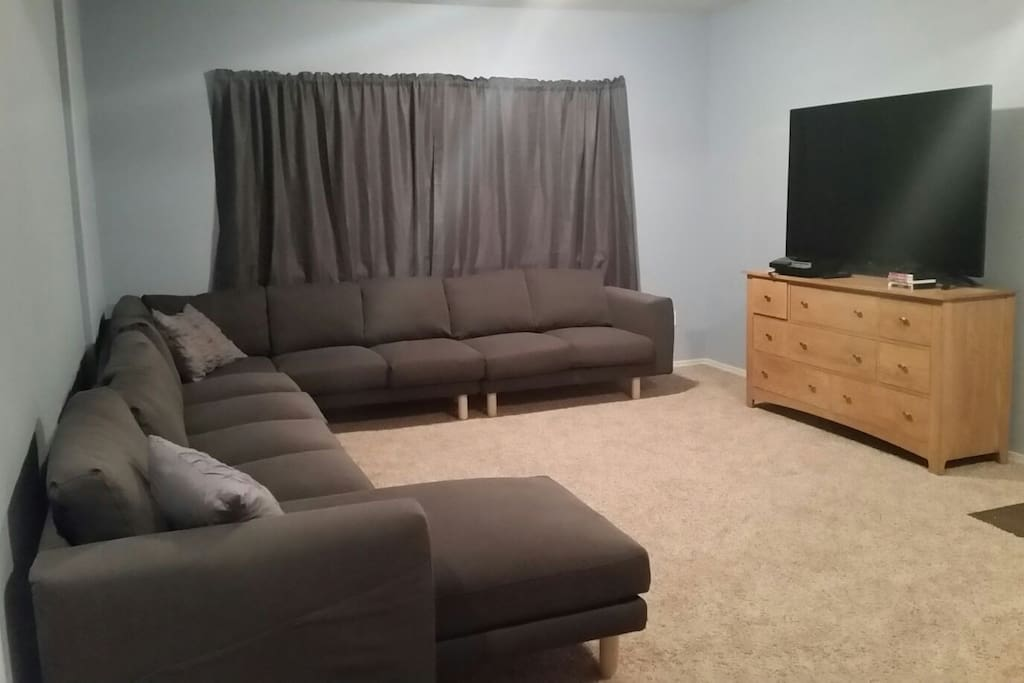 Spread out on the 9-seat couch and relax with some Netlfix on the 70 inch flat screen TV.