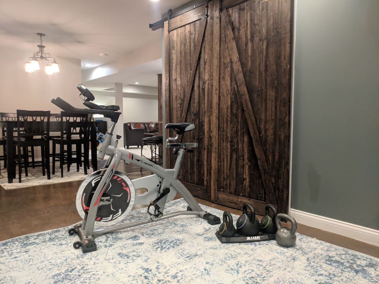 Stationary bike and kettle bells for your use.